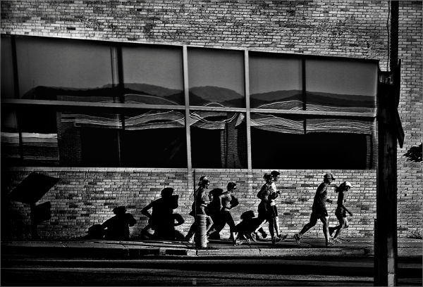 Runners Racing Through A City