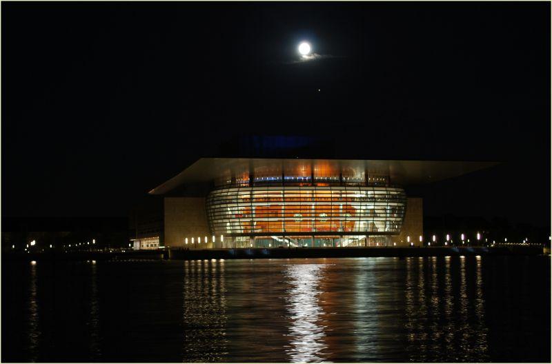the copenhagen opera house at moonlit night