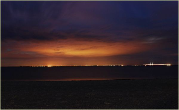 The coast of Sweden and Øresund bridge at night