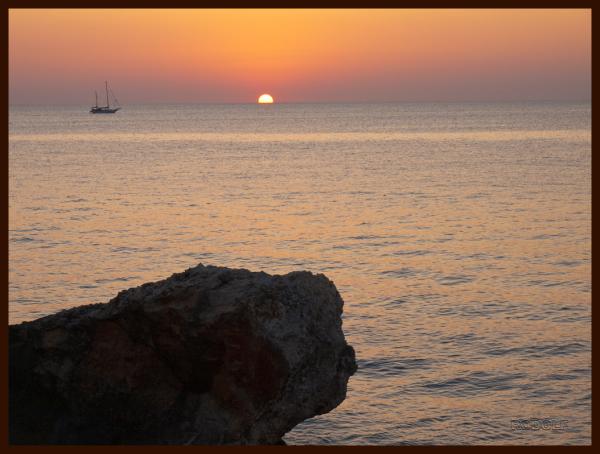 The putting sun in Cala Blanca Menorca