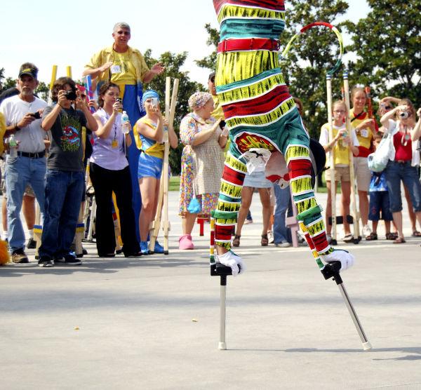 Cirque performer does  an inverted stilt walk.