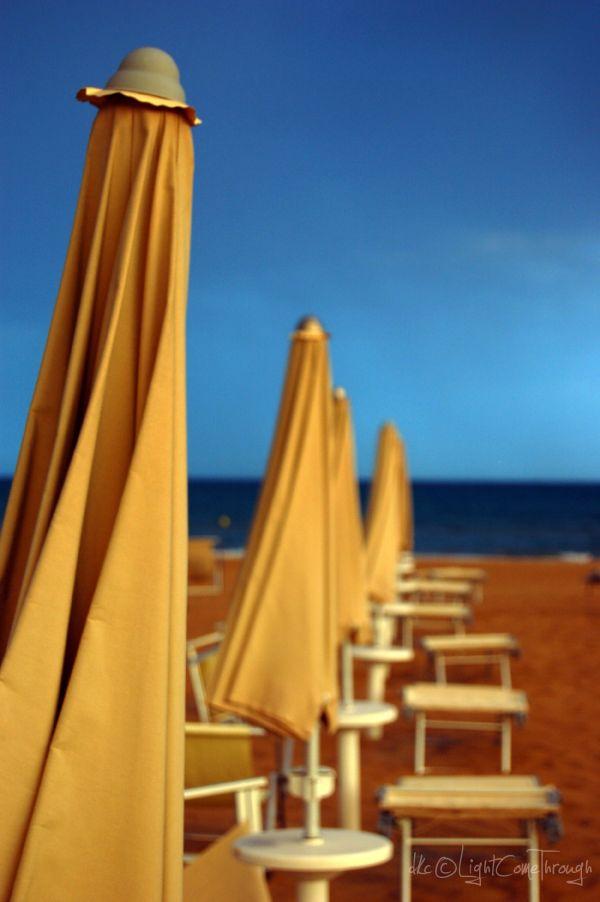 Umbrellas with blue sky...