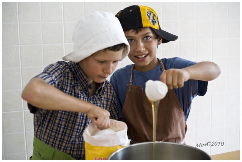 Two boys baking