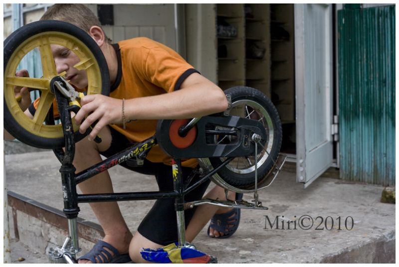 A boy a reparing a bike
