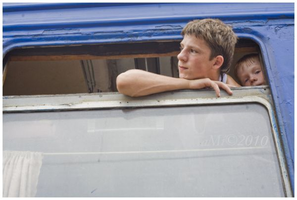 two boys at the ukrainian train window