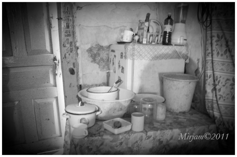 a poor family's kitchen in a room