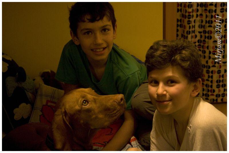 2 boys with a dog