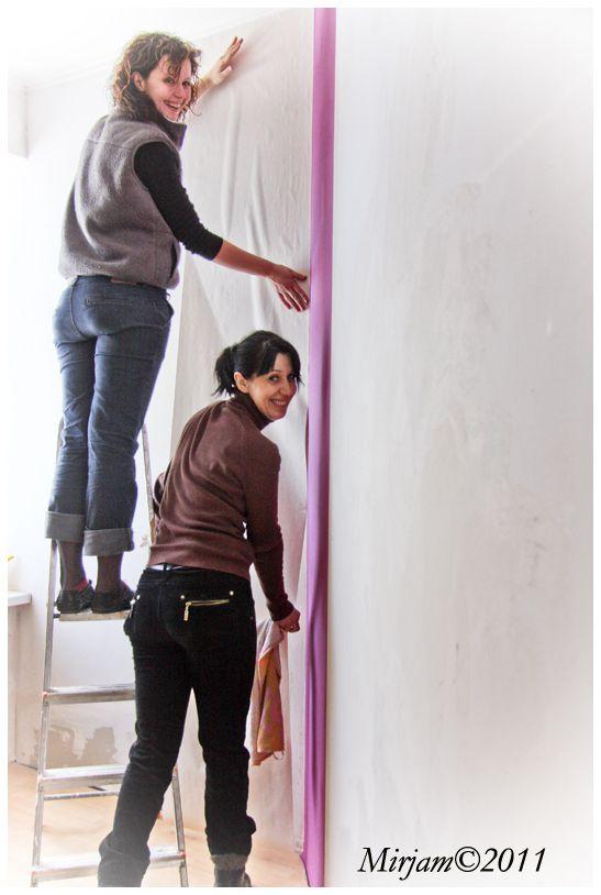 2 ladies setting up wallpaper