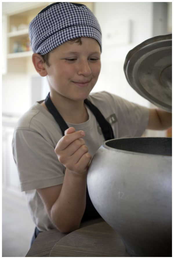 a boy in a kitchen