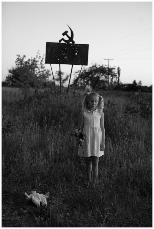 Old Soviet sign, a girl and dolly