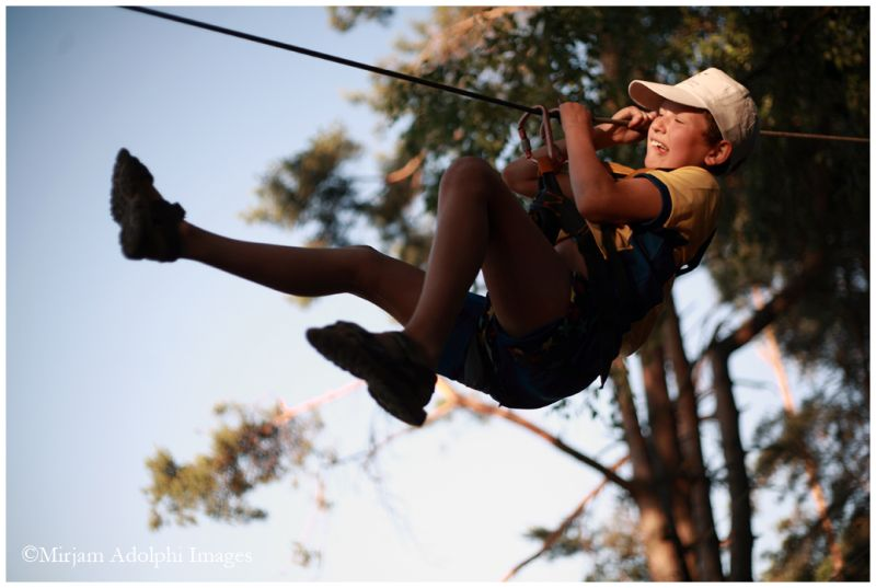 A boy hanging on rope, on the air