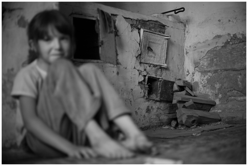 a child in a room with firewood