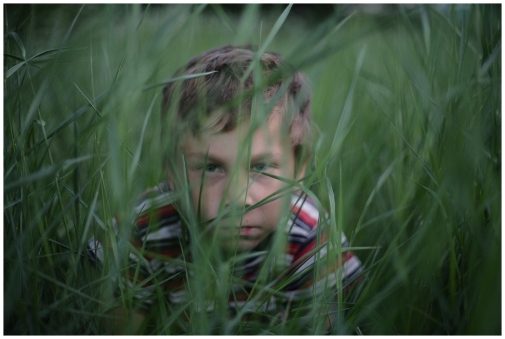 A child hiding in grass