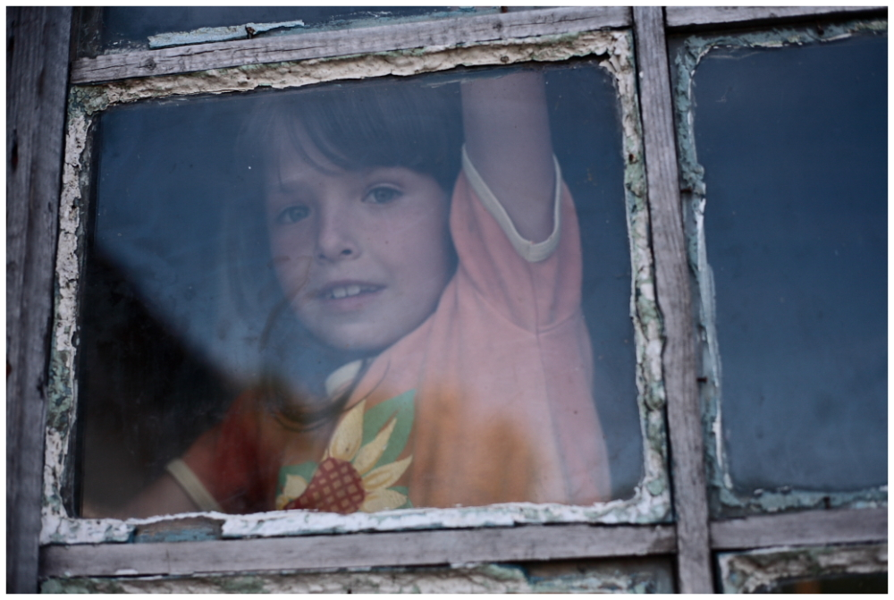 a child behind the window