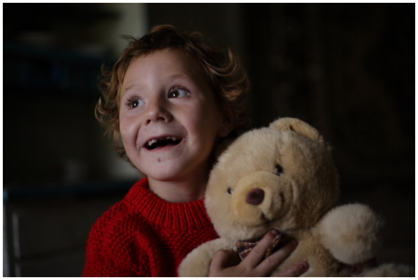 a child with a teddy bear