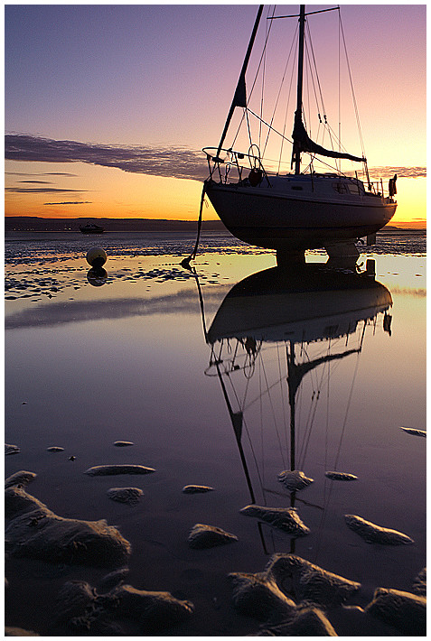 boat at sunset on the Dee Estuary Wirral