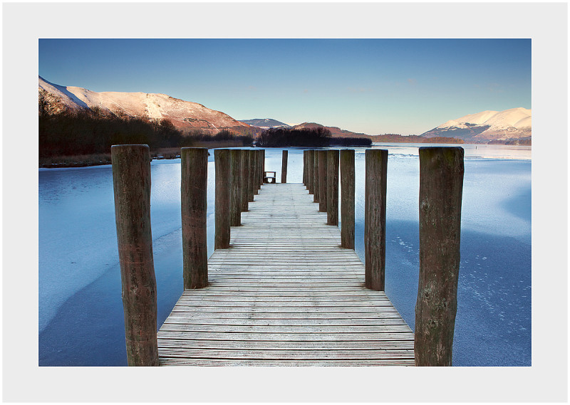 jetty over frozen derwentwater winter