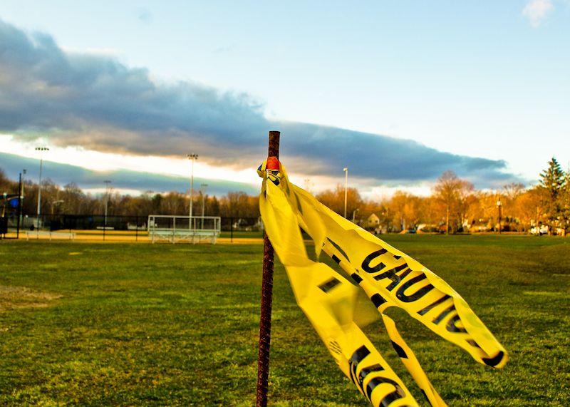 caution sign rain cloud field grass green