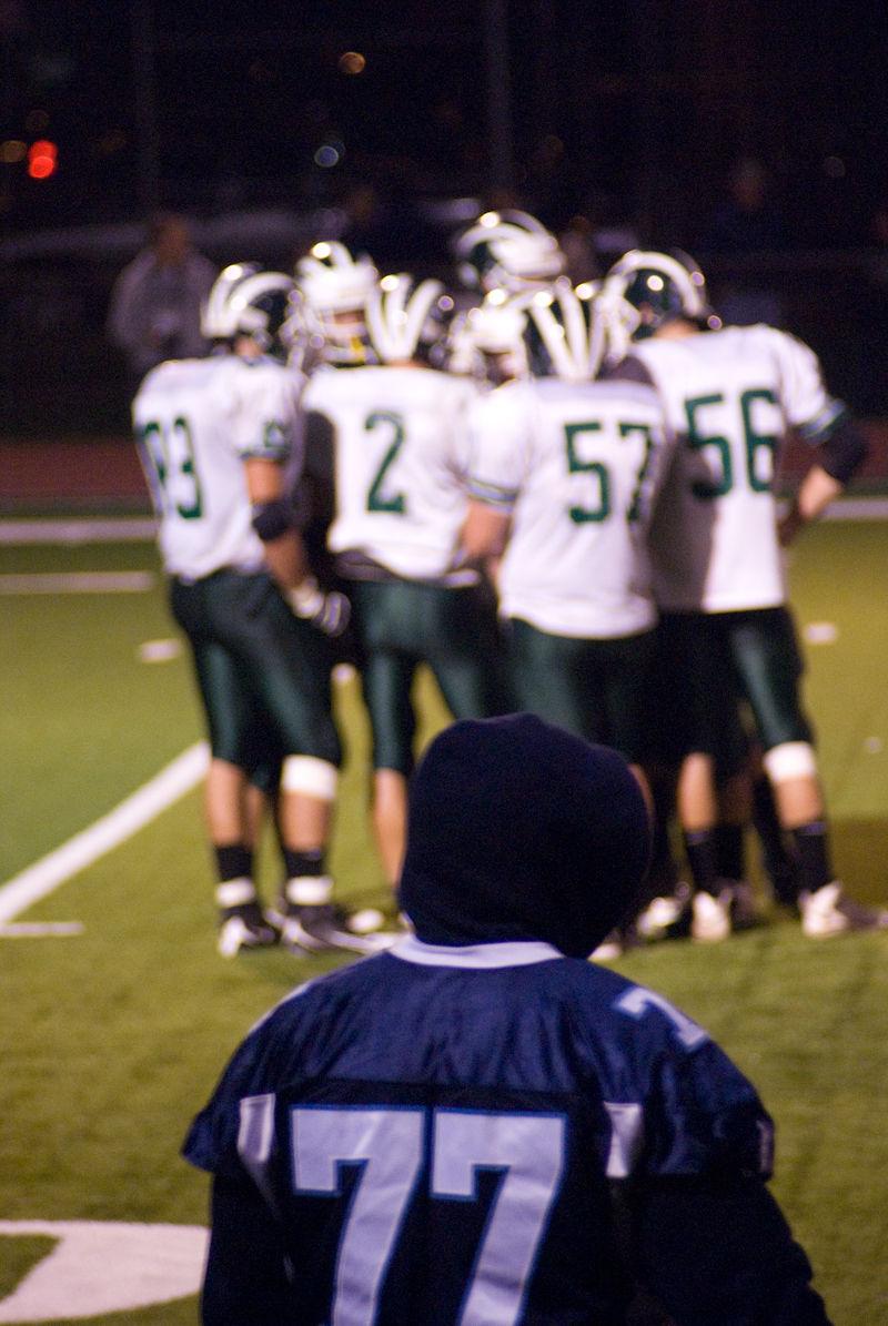 football team huddle alone high school