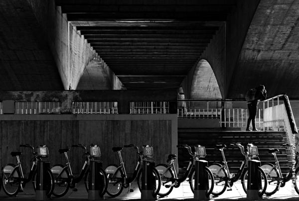 A photographer under Waterloo Bridge