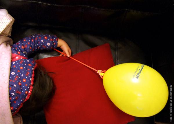 Sleeping girl with yellow balloon