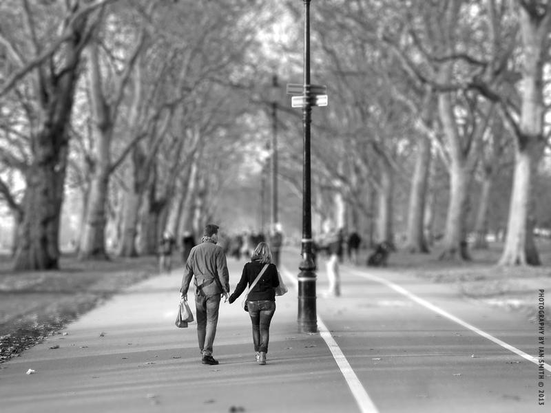 Lovers walking in Hyde Park London