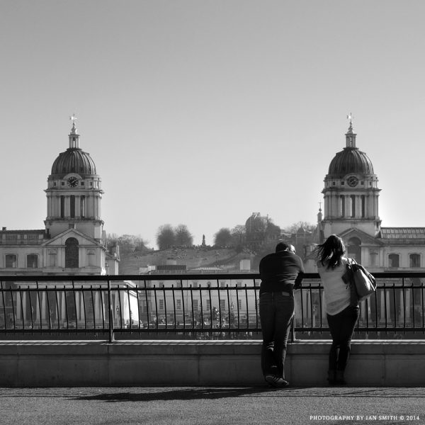A couple looking across to the Royal Naval College
