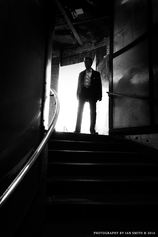 Silhouette of a man at the top of the stairs