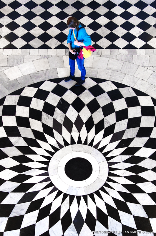 Colourful woman on a chequered floor