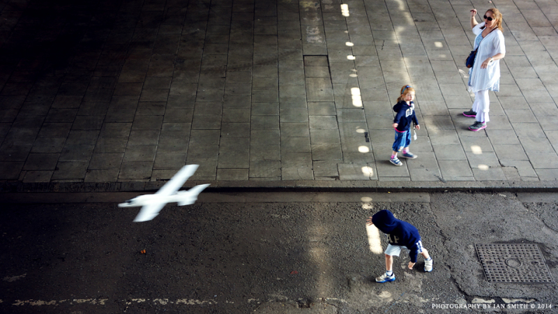 Children playing under the Hungerford Bridge