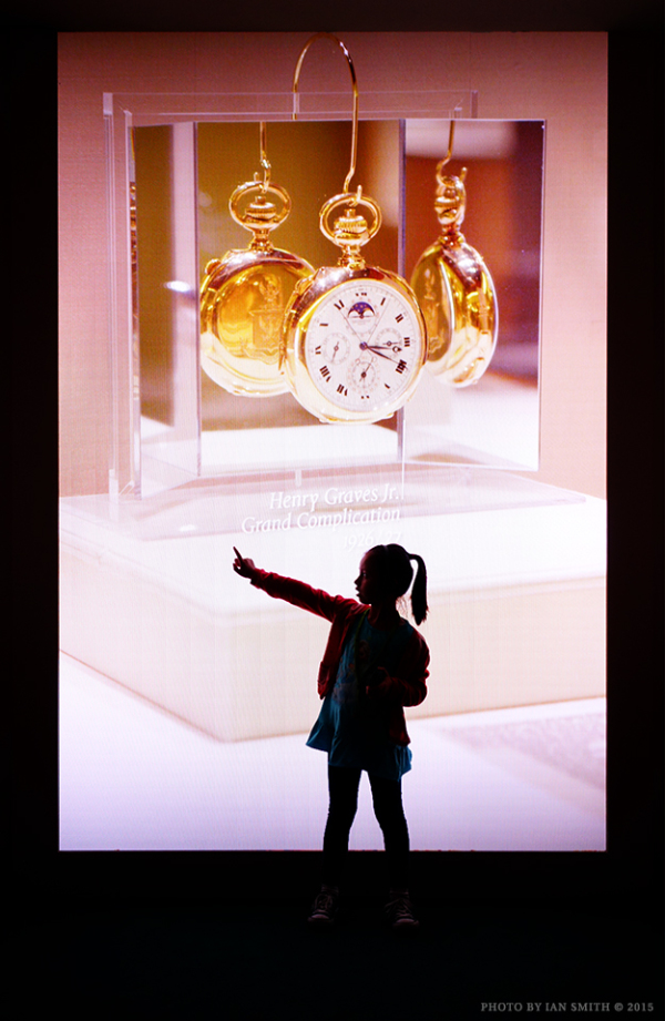 Young girl in front of digital display
