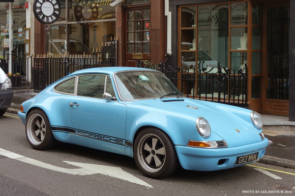A 1989 light blue Porsche 911 in London