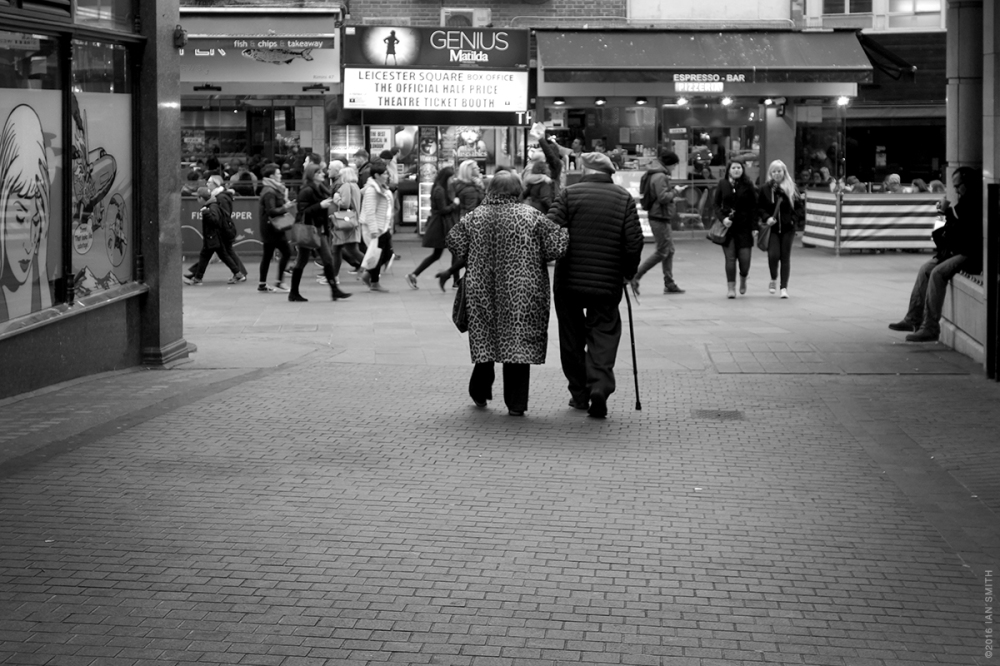 Elderly couple heading in to Leicester Square