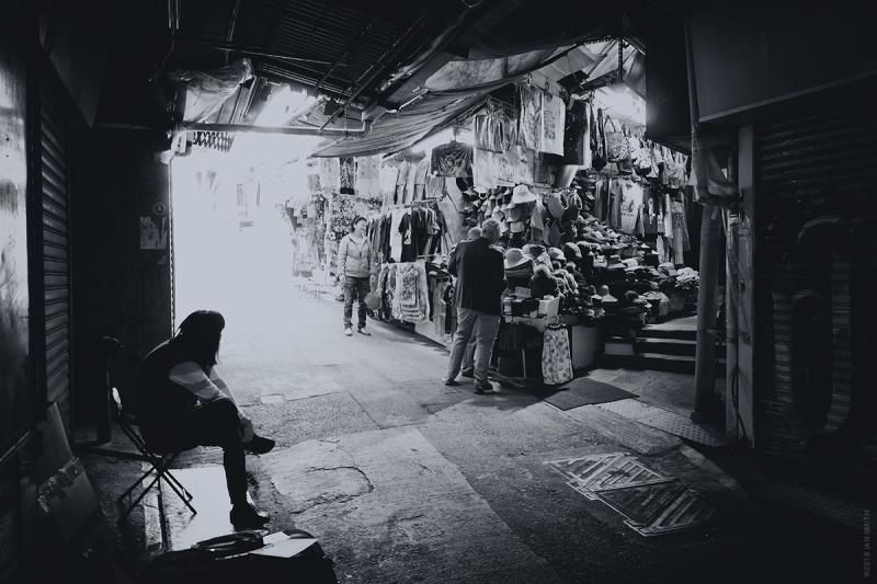 Buying hats in Stanley Market, Hong Kong