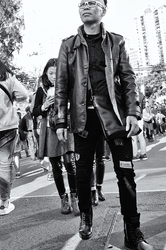 Leather clad man and girls in Hong Kong