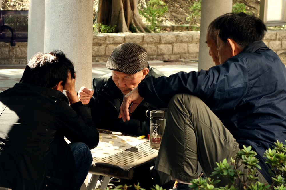 Elderly men playing Chinese Chess
