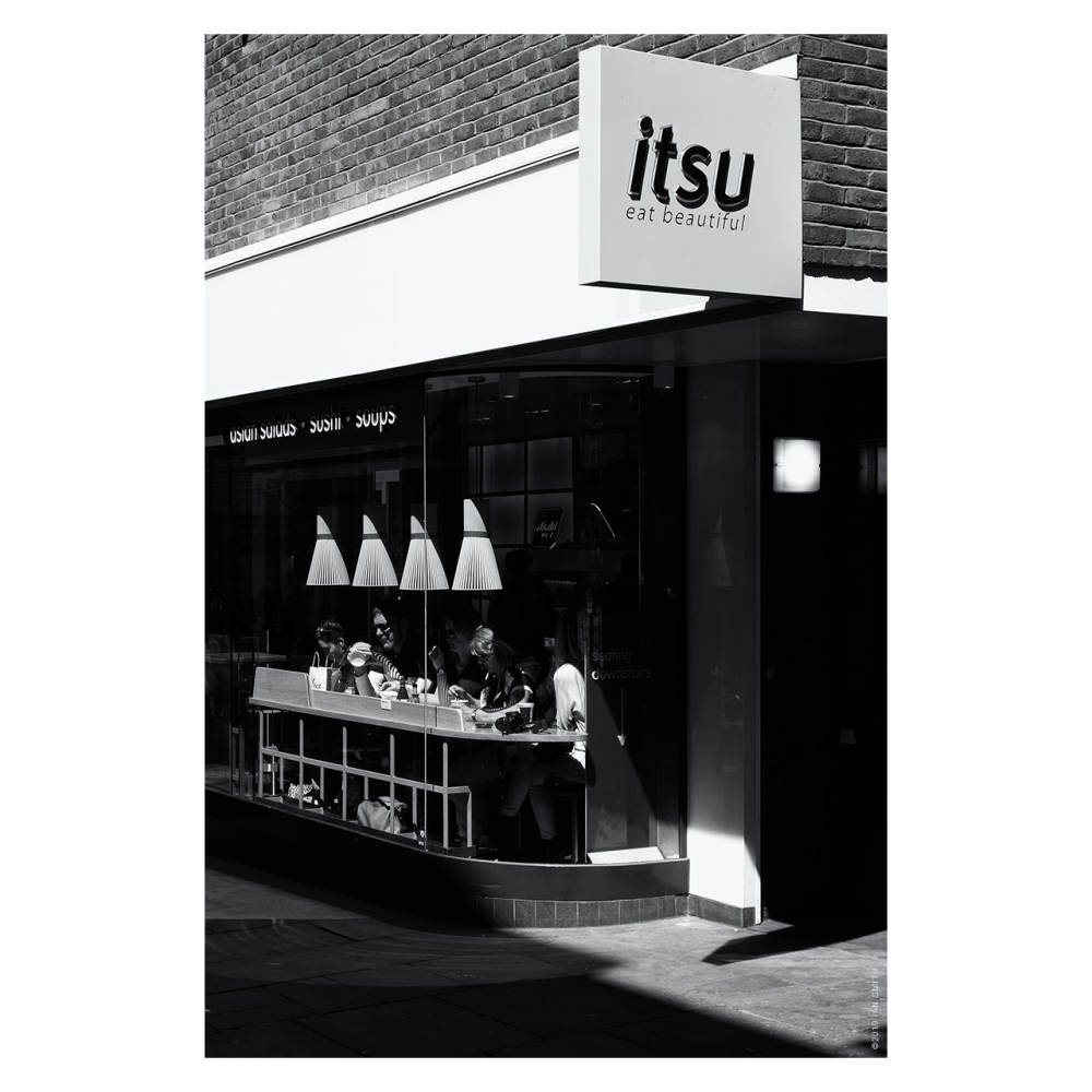 Sunlit diners in an itsu in Covent Garden, London