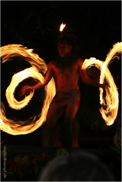 Fire twirling luau