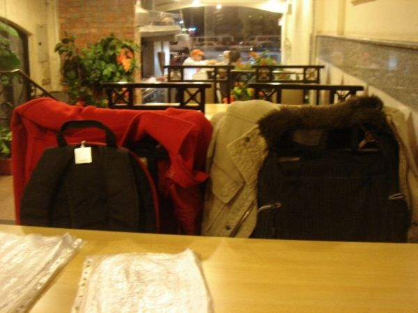 Two Jackets Amid Chairs