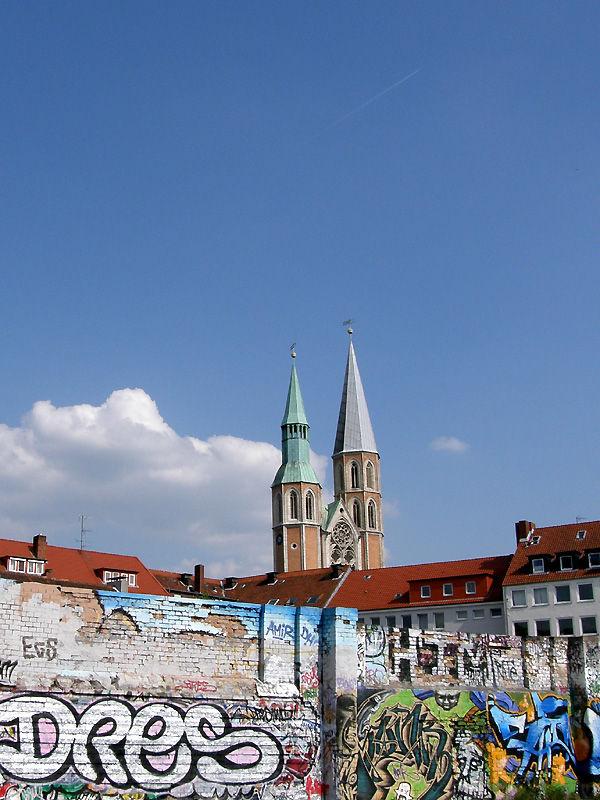 graffiti wall and old church