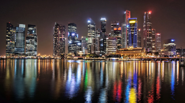 singapore night skyline water reflection