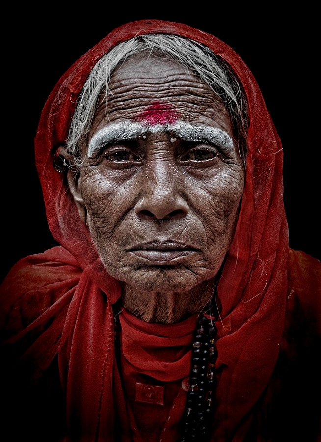 street portrait woman red scarf Indian Pushkar