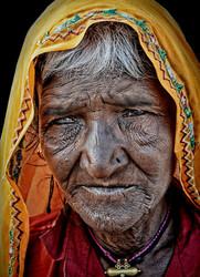 old Indian woman Haridwar portrait street homeless