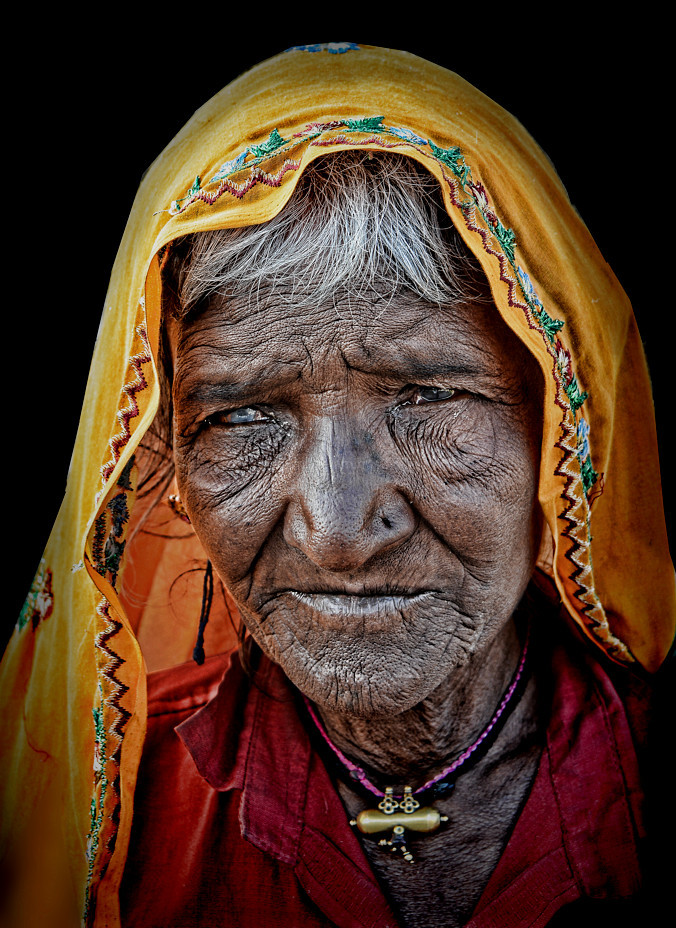 old Indian woman Haridwar portrait street homeless
