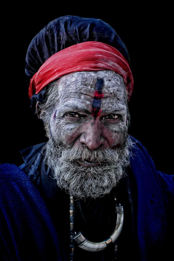 hindu sadhu Rishikesh India blue tunic turban face