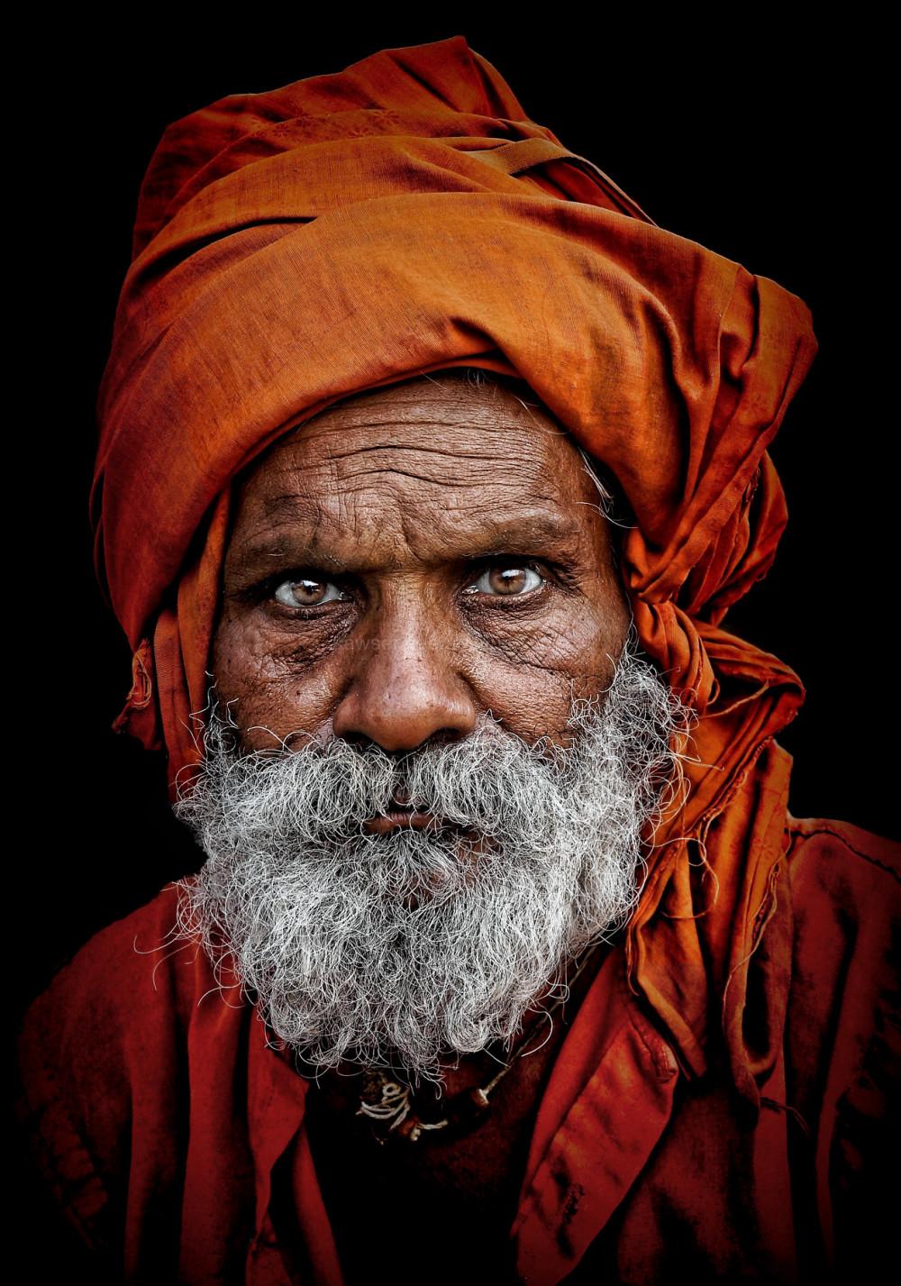 hindu pilgrim saffron colour street portrait India