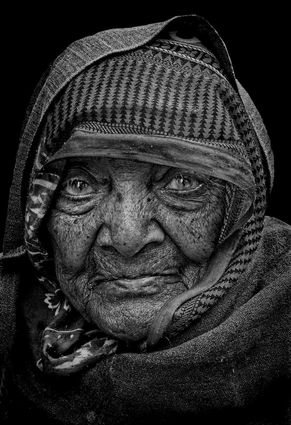 matriarch Rajasthani woman monochrome natural lite