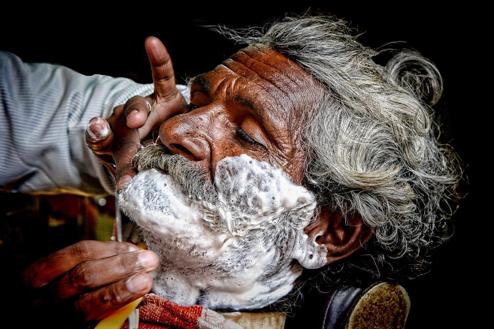 barber shaving outdoor naturallight portrait India