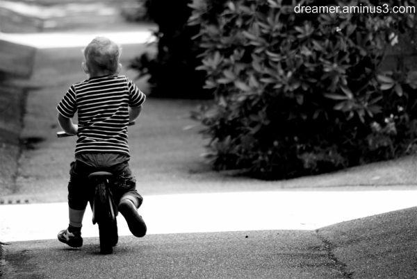 Black and white, boy on motorbike