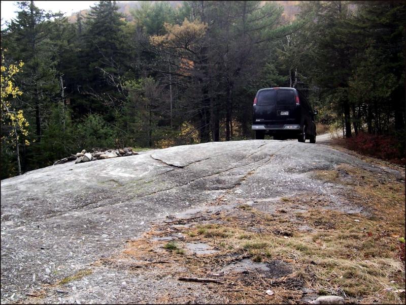Van parked on rock